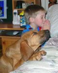 kid praying with dog.jpg